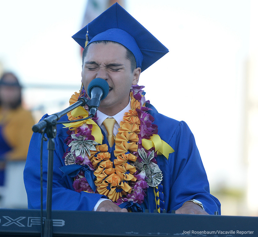 ". Graduate Lucas Goss performs an original piece of music he wrote with fellow graduate Grant Campbell titled, ""This Is Our Home\"" during graduation."