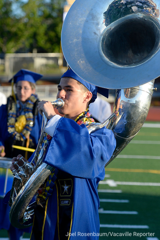 ". Graduate Vincent Topete plays the sousaphone with his fellow members of the Wood band and orchestra as they perform ""Hey Brother\"" by Avicii during graduation."