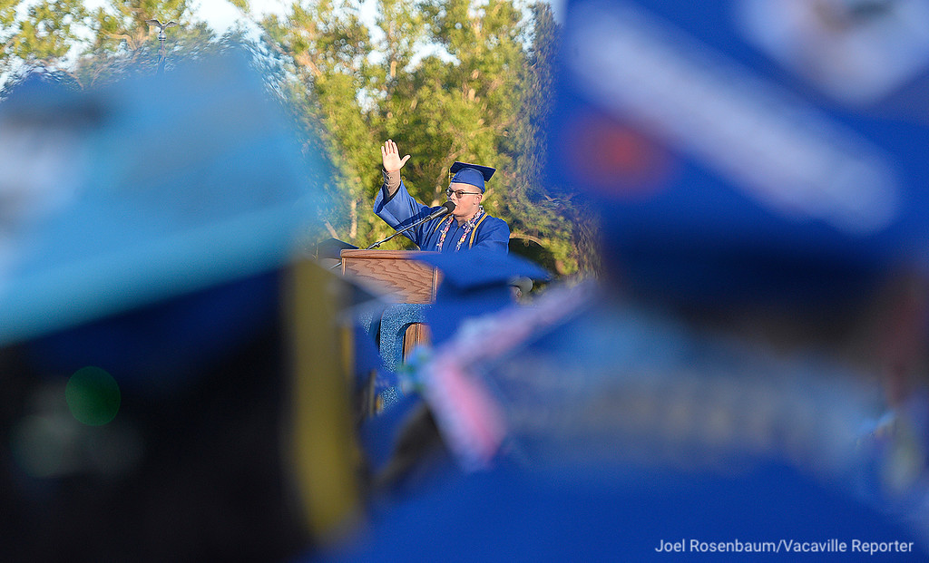. Senior class speaker, Austin McLellan gestures to his fellow graduates as his finishes his remarks during Friday\'s commencement ceremony at Wood. Joel Rosenbaum -- The Reporter