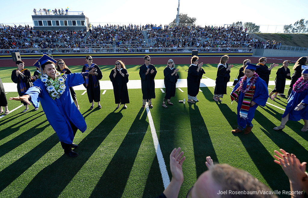 . Will C. Wood graduating senior, Tyreese Carson dances past applauding teachers during the processional at the beginning of the 2018 graduation ceremonies in the brand new Wildcat Stadium Friday at Wood. For the first time in its nearly 30 years as a high school, students were able to graduate at their own campus.