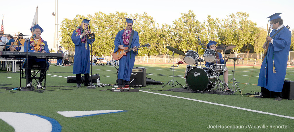 ". Will C. Wood graduates (from left) Lucas Goss, Carson Lamb, Grant Campbell, Megan Albidress and Jacob Goodling  perform an original piece of music written by Goss and Campbell titled, ""This Is Our Home\"" during graduation."