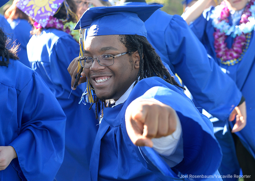 . Wood\'s Brandon Bradley hams it up while waiting to march in procession into Wildcat Stadium Friday during graduation ceremonies for the Will C. Wood class of 2018. The first even on the school\'s campus.