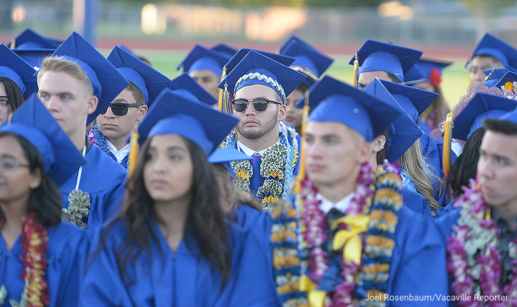 . Will C. Wood graduate, Aydan Cocuzza  listens as school board member, Michael Kitzes delivers his remarks during graduation ceremonies Friday at Wood.