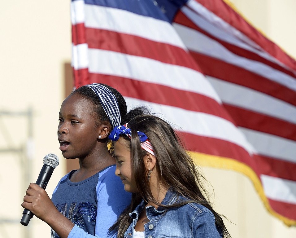 """. Scandia Elementary School sixth graders, Myla Toliver, 10 (left) and Victoria Norman, 11 sing \""""God Bless America\"""" during 9/11 Freedom Walk Ceremony Monday at the Airman and Family Readiness Center on Travis Air Force Base. Joel Rosenbaum -- The Reporter"""