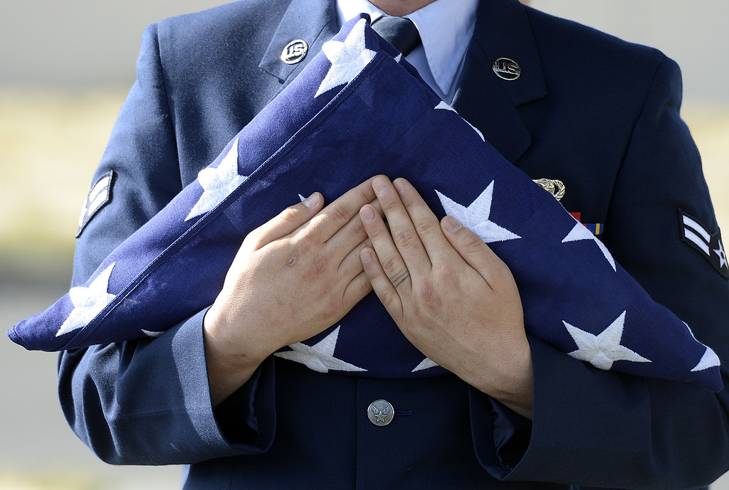 . United States Air Force Airman 1st Class, Tanner O\'Laughlin, a member of the Travis Air Force Base Honor Guard holds an American Flag.  Joel Rosenbaum -- The Reporter