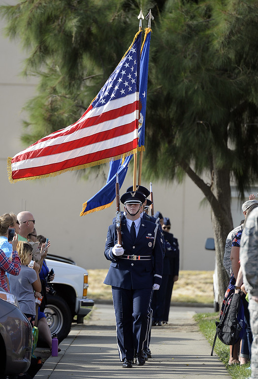 . Members of the Travis Air Force Base Honor Guard present the colors as the beginning of the Freedom Walk Ceremony Monday at the Airman and Family Readiness Center on base. Students from Travis and Scandia Elementary School walked from their campuses to the center to honor the memories of the victims and survivors of 9/11. Joel Rosenbaum -- The Reporter