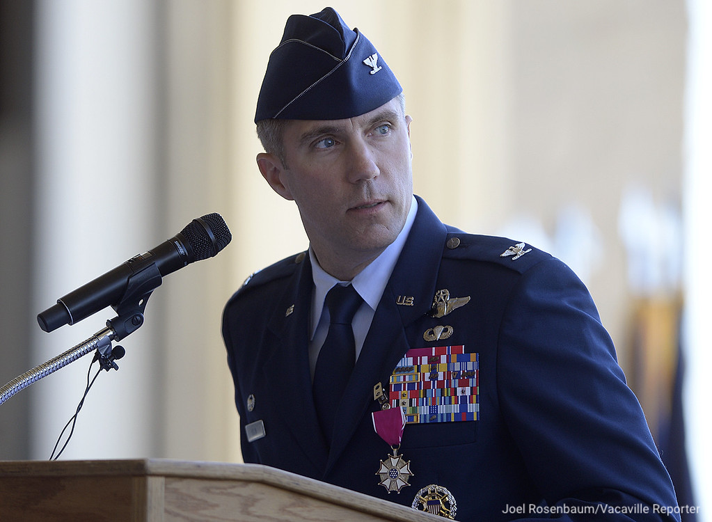 . United States Air Force Colonel John M. Klein, Jr., the outgoing commander of the 60th Air Mobility Wing delivers his remarks during a the during a change of Command Ceremony Tuesday, at Travis Air Force Base in Fairfield. Klein received an assignment at the Council of Foreign Relations in New York City.