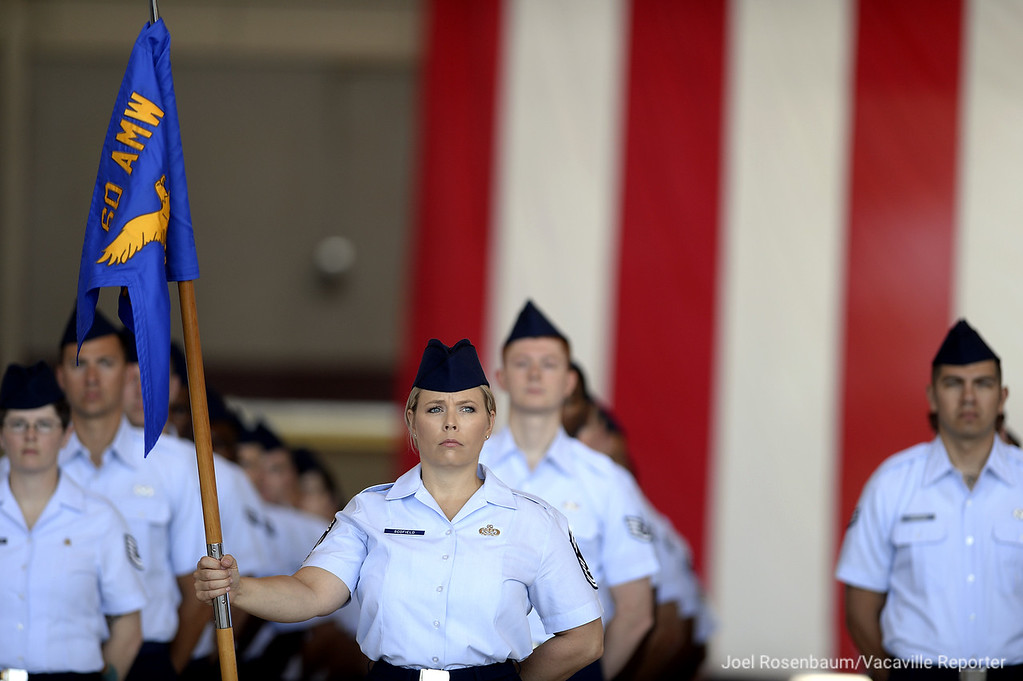 . United States Air Force personnel of the 60th Air Mobility Wing at Travis Air Force Base stand in formation Tuesday during a Change of Command ceremony for new base commander, Colonel Ethan C. Griffin.