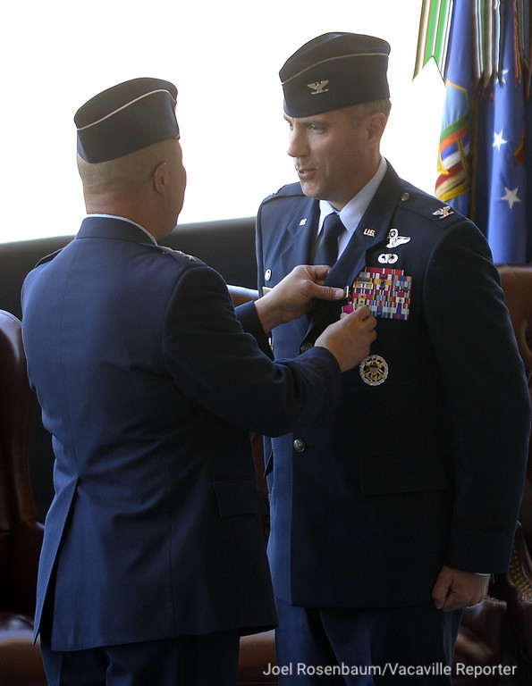 . United States Air Force Colonel John M. Klein Jr., (right) smiles after he received a Legion of Merit medal from Lt. General Giovanni K. Tuck commander 18th Air Force after he was honored for his service as 60th Air Mobility Wing Commander during a Change of Command Ceremony Tuesday at Travis Air Force Base.