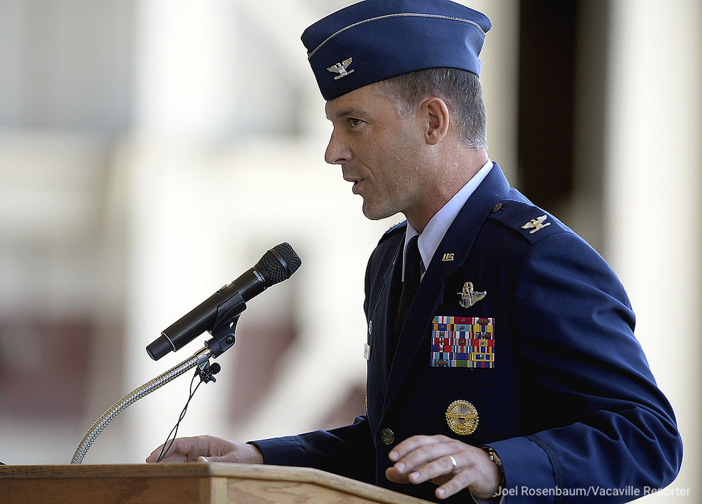 . United States Air Force Colonel Ethan C. Griffin., new commander of the 60th Air Mobility Wing delivers his remarks during a the during a change of Command Ceremony Tuesday, at Travis Air Force Base in Fairfield. Griffin assumes command of the base after serving as the commander of the 436th Airlift Wing at Dover Air Force Base in Delaware.