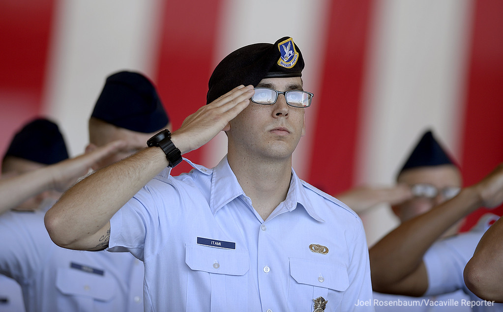 . United States Air Force personnel of the 60th Air Mobility Wing at Travis Air Force Base salute outgoing base commander, Colonel John M. Klein Jr. Tuesday during a Change of Command ceremony for new base commander, Col. Ethan C. Griffin Tuesday at Travis Air Force Base.