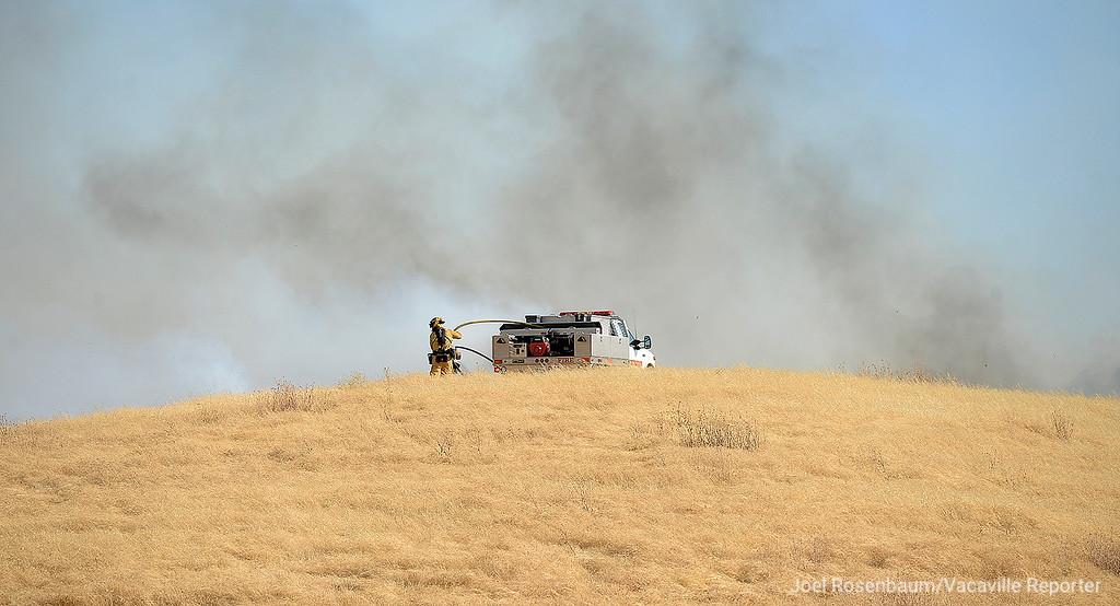. A firefighter from the Fairfield Fire Department make an attack on the hillside above eastbound Interstate 80 near Nelson Road. The 1,000 acre grass fire that started along the freeway and burned between Vacaville and Fairfield.