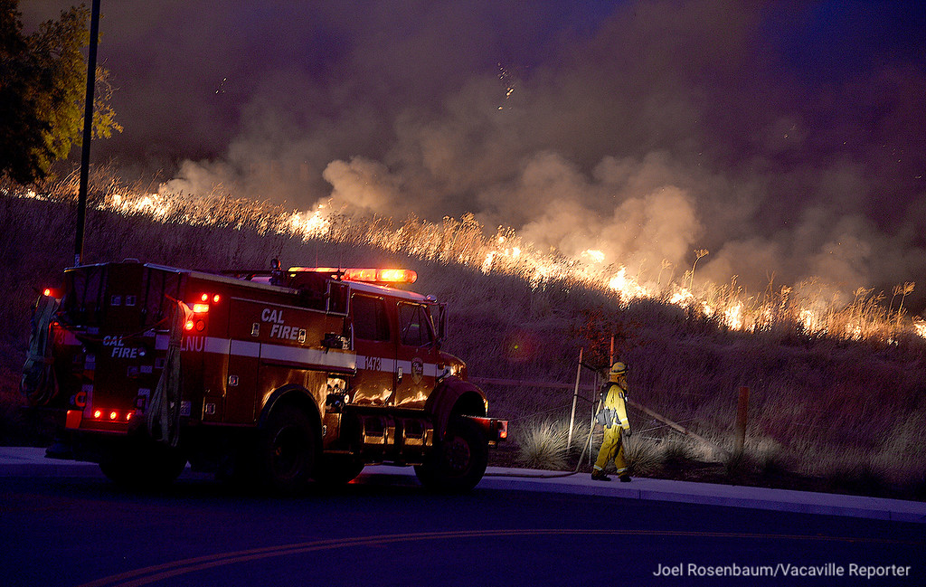 . Firefighters from the California Department of Forestry and Fire Protection monitor the progress of the Nelson Fire as it burns toward Discovery Way in Fairfield Friday as they provide structure protection for the homes in the Gold Ridge subdivision along Peabody Road.