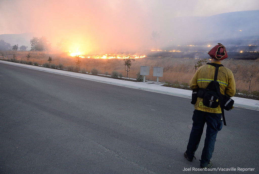 . Vacaville Fire Department Captain, Ryan Purnell monitor the progress of the Nelson Fire as it burns toward Discovery Way in Fairfield Friday as they provide structure protection for the homes in the Gold Ridge subdivision along Peabody Road.