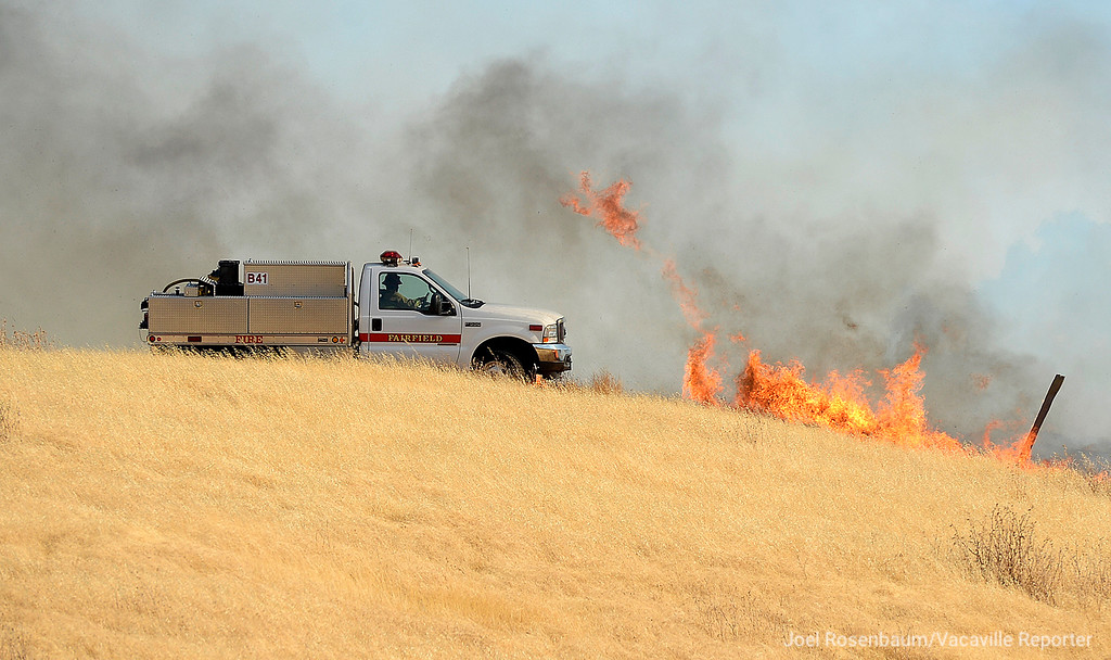 . Firefighters from the Fairfield Fire Department make an attack on the hillside above eastbound Interstate 80 near Nelson Road. The 1,000 acre grass fire that started along the freeway and burned between Vacaville and Fairfield.