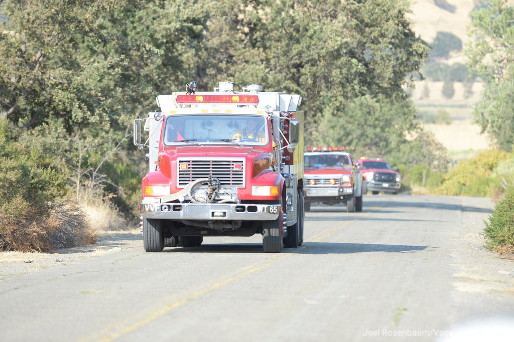 . Crews from the Vacaville Fire Protection District roll along Nelson Road in Vacaville Friday as they prepare to make an attack on a portion of a 1,000 acre grass fire that burned the hills between Vacaville and Fairfield.