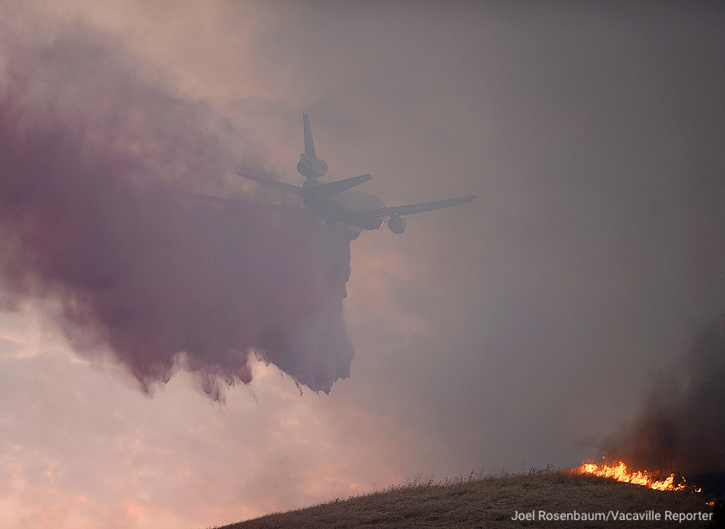 . A contract air tanker makes a fire retardant drop on hillside above Discovery Way Friday in Fairfield. The VLAT (very large air tanker) was one of 6 fixed wing aircraft that were dispatched to the a large grass fire that burned about 1,000 acres between the cities of Vacaville and Fairfield.