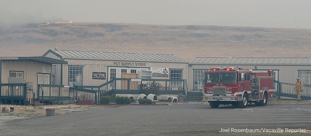 . A fire crew from the Vacaville Fire Department provides structure protection at the SPCA animal shelter on Peabody Road in Vacaville. The animals at the shelter were evacuated from the complex.