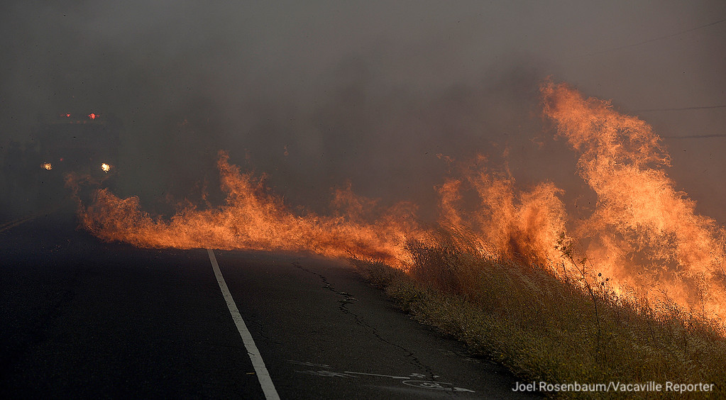 . Flames flare up along Peabody Road between Vacaville and Fairfield as a fire crew from Napa County prepares to make an attack as the fire burns toward the Foxboro neighborhood of Vacaville.