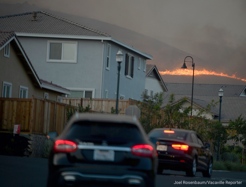 . Flames above homes in the Gold Ridge subdivision in Fairfield. The Nelson Fire that started along eastbound Interstate 80 near Lagoon Valley had consumed 1,000 acres between Vacaville and Fairfield and was 10 percent as of 11 P.M.