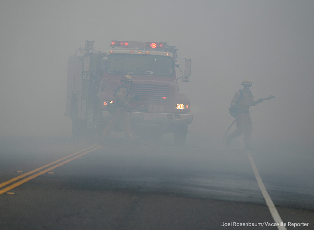 . A fire crew from Napa County prepares to make an attack of a portion of the Nelson Fire Friday as the fire burns toward the Foxboro neighborhood of Vacaville.