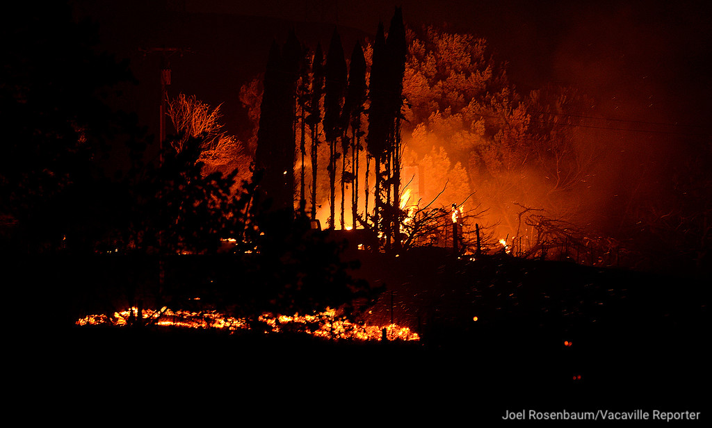 . Flames burn in a home in hills above Peabody Road Friday night as the 1,000 acre Nelson Fire burns . The home was the only one that was destroyed in the blaze.