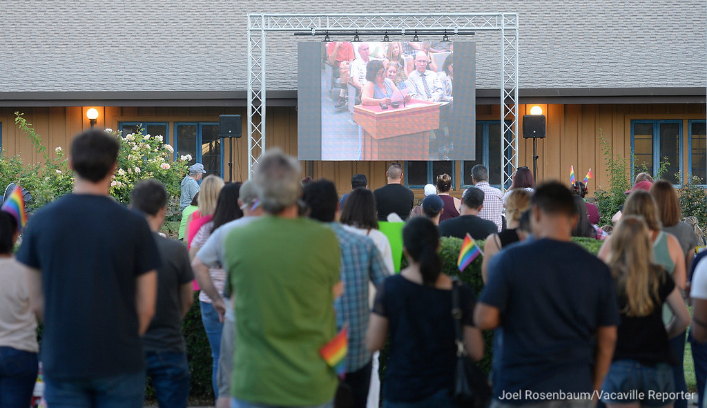 . With the council chambers filled to capacity, protestors gather outside of Dixon City Hall watch the Tuesday\'s city council meeting on a big screen set up on the lawn. Citizens from Dixon and surrounding cities packed the city council chambers and the lawn outside to raise their voices in protest of Vice Mayor Ted Hickman and his  newspaper column where he was campaigning for Straight American Pride Month and referred to members in the LGBTQ community as �tinkerbells� and �faries� (sic).