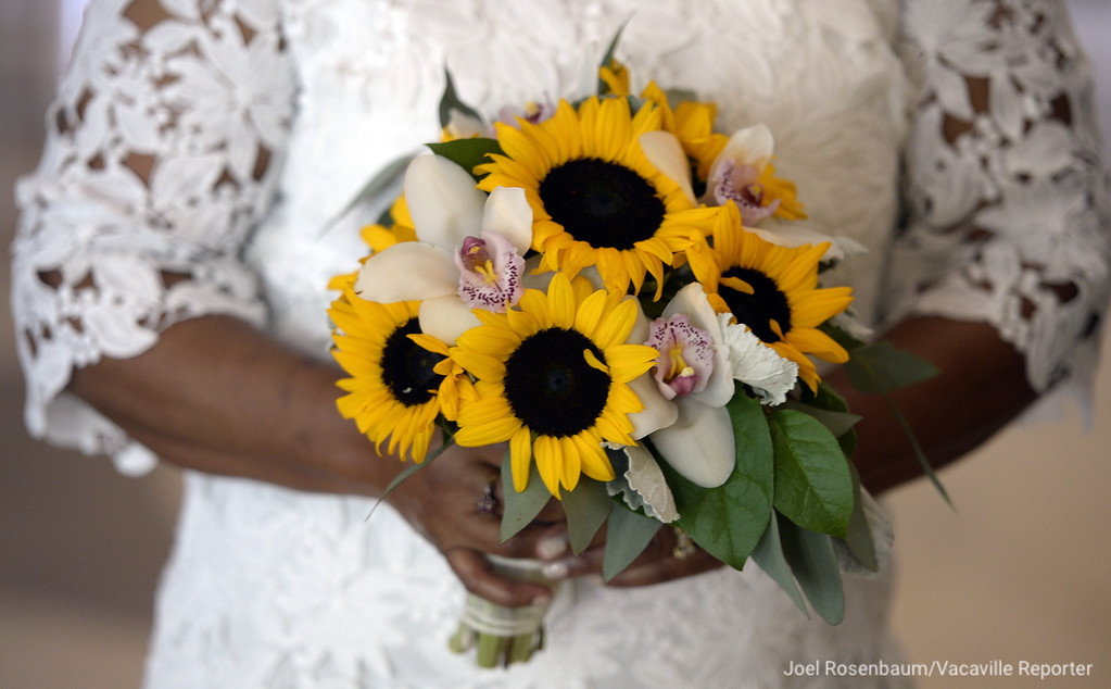 . Carolyn Brown (nee:Graham) holds her bouquet while waiting for her wedding ceremony to begin Thursday at the Solano County Government Center. Brown exchanged marriage vows with her husband, Melton Brown in a civil ceremony Thursday in Fairfield. Joel Rosenbaum -- The Reporter