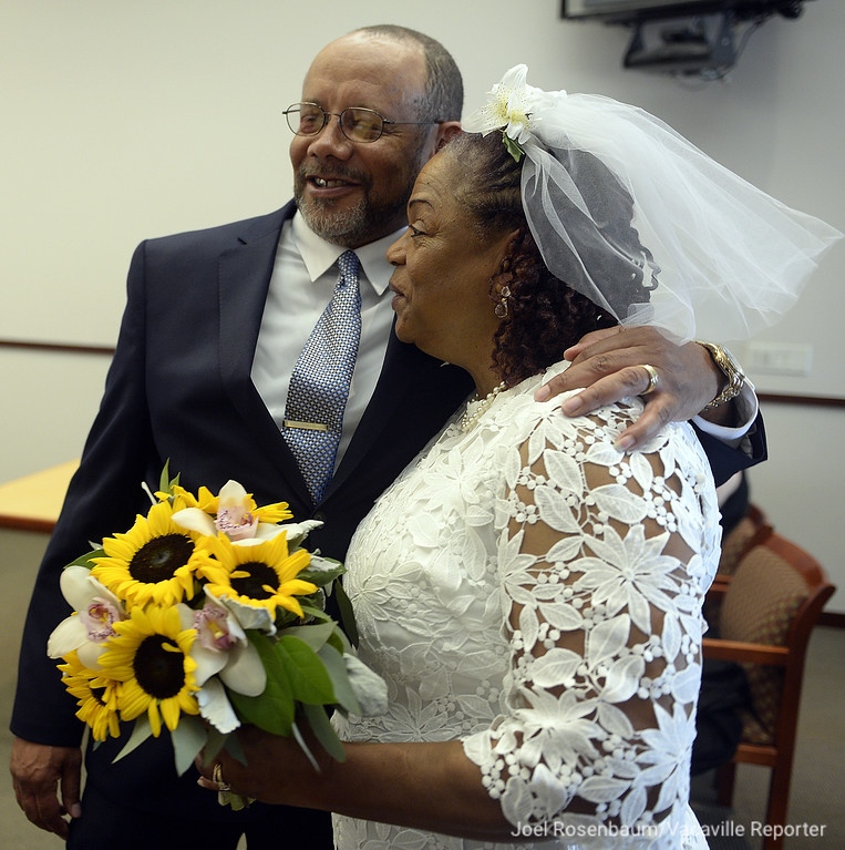 . Melton and Carolyn Brown of Vallejo catch their breath after the two were married in a civil marriage ceremony Thursday at the Solano County Goverment Center. Joel Rosenbaum -- The Reporter
