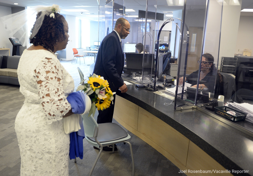 . Carolyn and Melton Brown of Vallejo file their marriage license with the Solano County Assessor/Recorder\'s officer after they were married in a civil ceremony Thursday at the Solano County Government Center in Fairfield. Joel Rosenbaum -- The Reporter