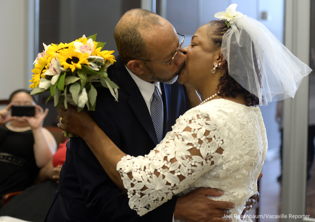 . Melton and Carolyn Brown of Vallejo have their first kiss as husband and wife after the two exchanged vows in a civil wedding ceremony Thursday at the Solano County Government Center. The marriages are performed Thursday afternoons by appointment. Joel Rosenbaum -- The Reporter