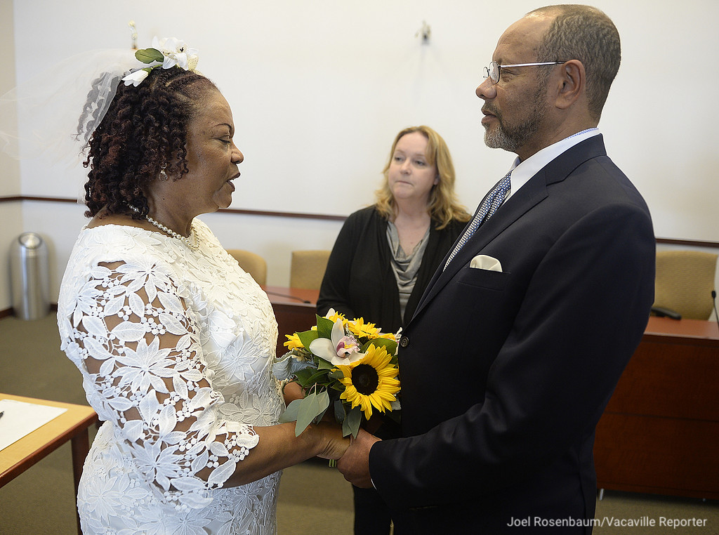 . Carolyn and Melton Brown of Vallejo exchange their marriage vows during a civil wedding ceremony Thursday officiated by Anna Manley, a Deputy Civil Marriage Commissioner with Solano County. The county offers couples the opportunity to tie the knot Thursday afternoons providing they make an appointment. Joel Rosenbaum -- The Reporter