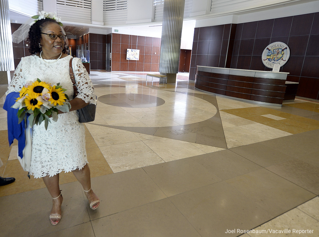 . Dressed in her wedding dress, Carolyn Brown (nee:Graham) of Vallejo waits in the foyer of the Solano County Government Center in Fairfield before she got married in a civil marriage ceremony. Joel Rosenbaum -- The Reporter