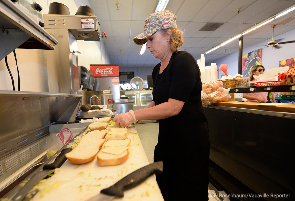 . Beth Barber an employee at Digger�s Deli in Vacaville make some of the 100 sandwiches that will be placed in box lunches to be delivered to the Dixon May Fairground which was designated a shelter for the residents of the Sonoma Developmental Center.