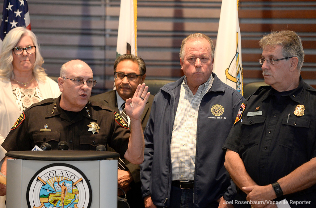 . Surrounded by goverment officials both local and state, Solano County Sheriff, Thomas A. Ferrara briefs members of the media on the status of the Atlas Fire Thursday at the Solano County Goverment Center.Joel Rosenbaum -- The Reporter