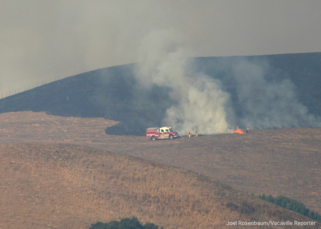. Firefighters attack a flare up on the ridge between Green Valley and Jameson Canyon Thursday morning. Crews continue to attack the Atlas Fire which briefly threatened home along Highway 12 before they could stop the progress.Joel Rosenbaum -- The Reporter