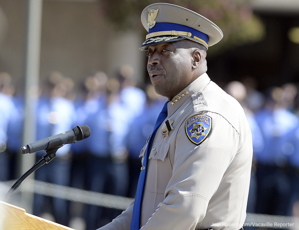 ". California Highway Patrol Commissioner Warren A. Stanley announces the ""end of watch\"" for officer Kirk Griess during a bell toll tribute ceremony at the CHP Academy Monday in West Sacramento."