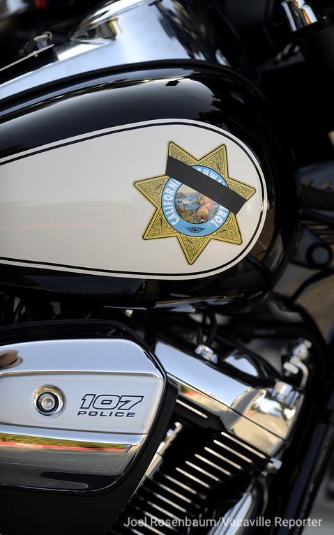 . A memorial ribbon for California Highway Patrol officer, Kirk Griess is affixed to the logo on the gas tank of one of the department\'s Harley Davidson motorcycle as it sits in the parking lot of the CHP Academy in West Sacramento Monday where a bell toll tribute was held for the fallen officer. Griess patrolled the freeways of Solano County on a motorcycle.