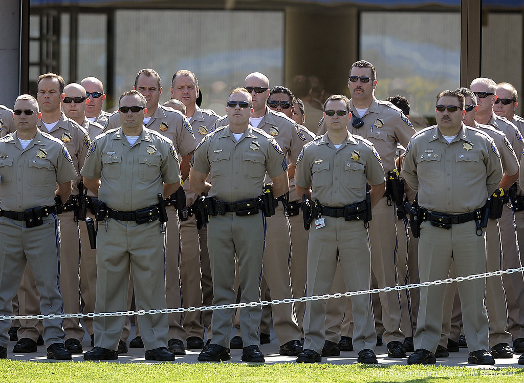 . California Highway Patrol officers stand at-ease during a bell toll tribute ceremony Monday at the CHP Academy that honored the memory of Kirk Griess who was killed last Friday will on a traffic enforcement stop on westbound Interstate 80 in Fairfield.