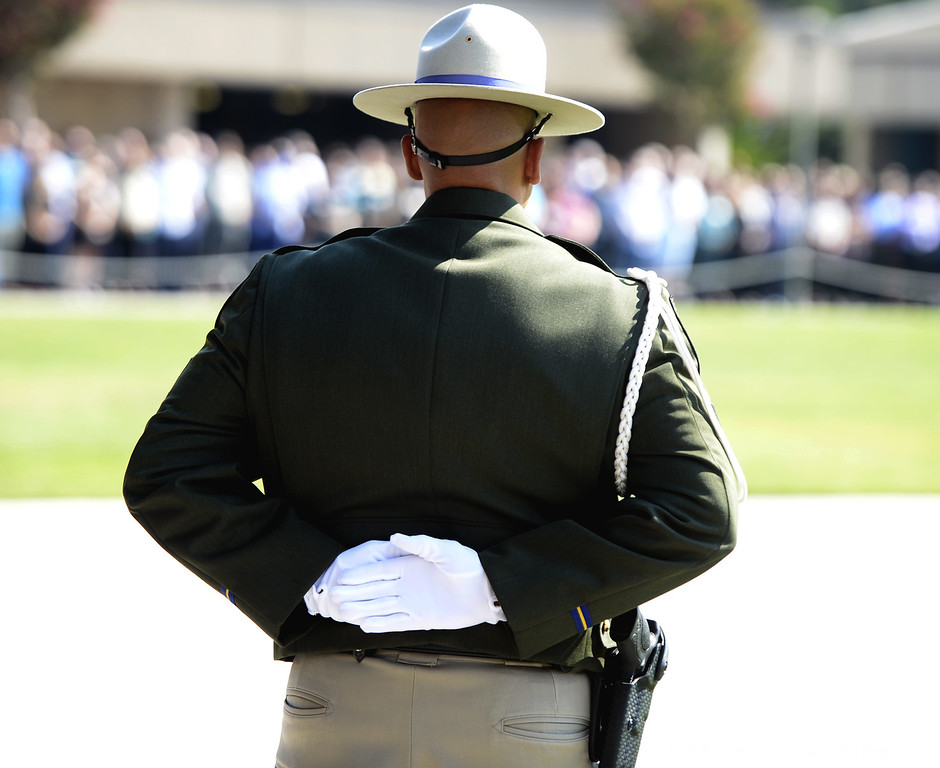 . California High Way Patrol Honor Guard member,  Sgt. Damian Blue stands at-ease during a bell toll tribute ceremony Monday at the CHP Academy in West Sacramento honoring the memory of Kirk Griess who was killed last Friday will on a traffic enforcement stop on westbound Interstate 80 in Fairfield.