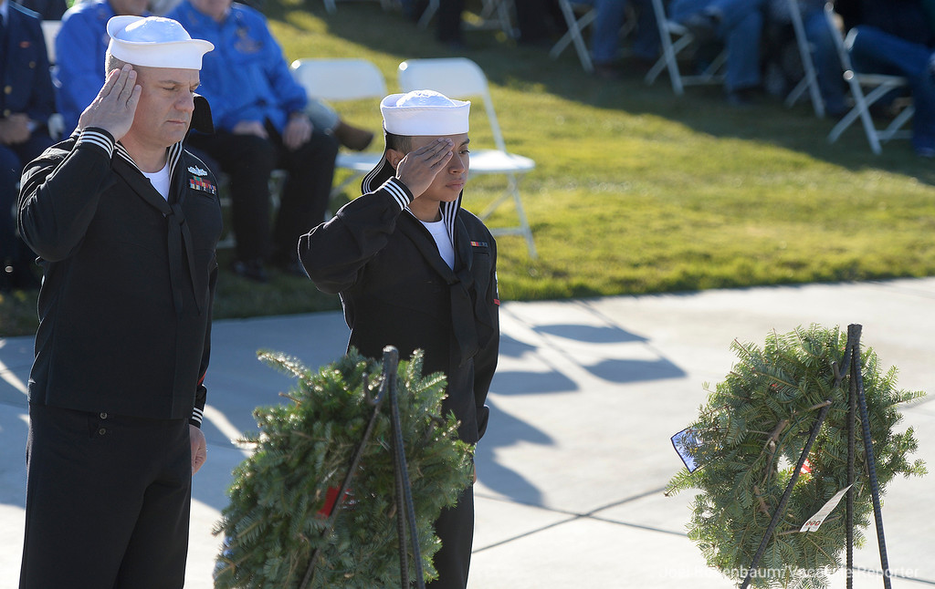 . United States Navy hospital corpsmen, Scott Ott (left) and J Rosales salute after placing a wreath honoring their fellow service members who are during at the Sacramento Valley National Cemetery during the Wreaths Across America Ceremony Saturday in Dixon.