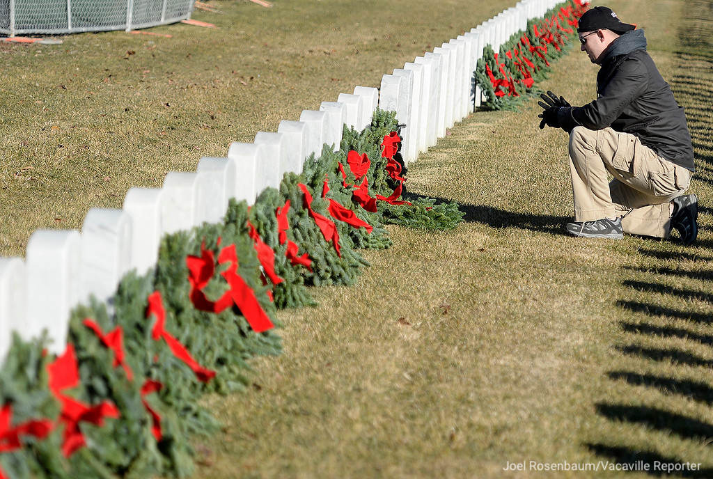 . Samuel Stewart of Sacramento pauses after placing a wreath on the headstone of his father who is buried at the Sacramento Valley National Cemetery  during the Wreaths Across America Ceremony Saturday in Dixon. The annual wreath laying event that started at Arlington National Cemetery over twenty years ago and has spread to veterans� cemeteries and other locations in all 50 states and beyond.