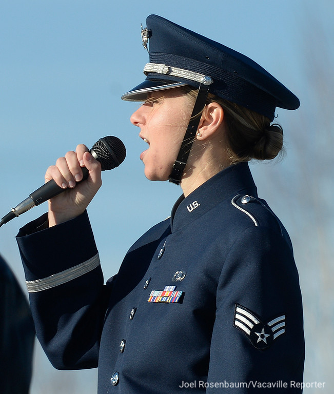 ". United States Air Force Sr. Airman, Michelle Doolittle of the USAF Band of the Golden West performs ""God Bless America\"" during Wreaths Across America Ceremonies."