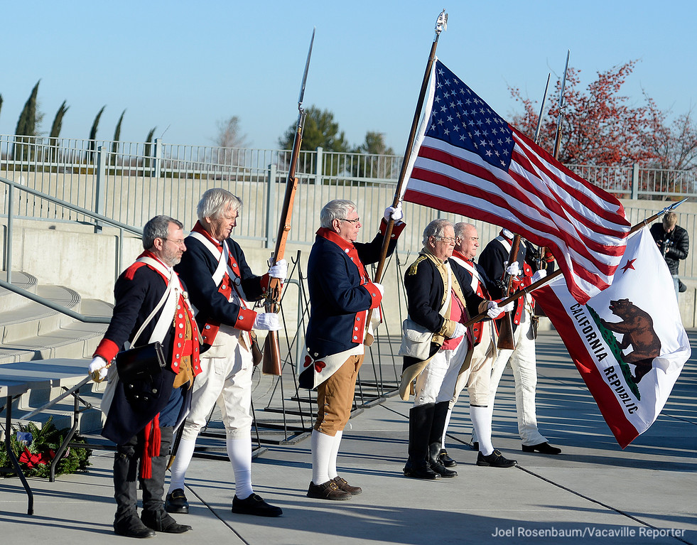 . Members of the California Society of the Sons of the American Revolution and the California State Color Guard present the colors at the beginning of the Wreaths Across America Ceremony at the Sacramento Valley National Cemetery in Dixon on Saturday.
