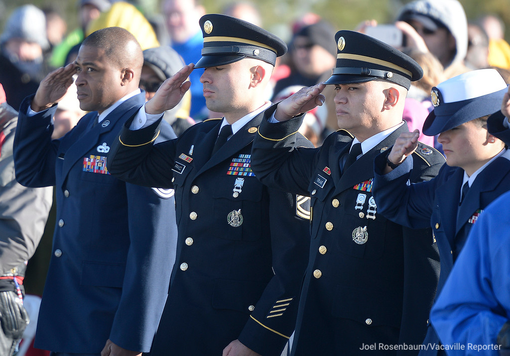 ". Members of United States Air Force, Army and Coast Guard salute as ""Taps\"" is played at the conclusion of the Wreaths Across America Ceremony on Saturday in Dixon."