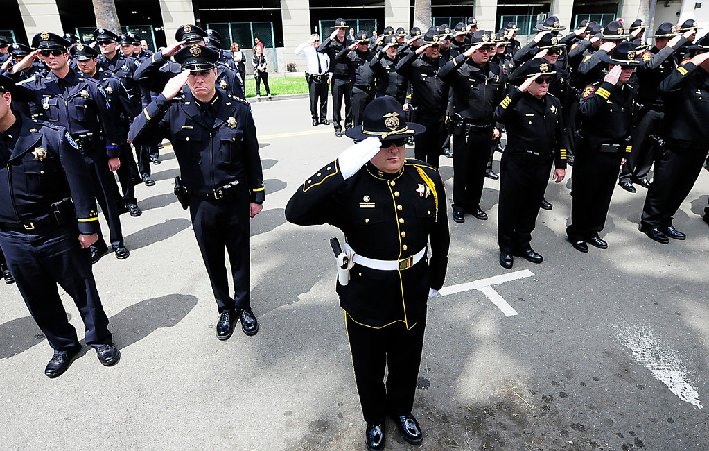 . FAIRFIELD, CA - MAY 16, Uniformed officers salute during the 2018 Peace Officers\' Memorial Service on Wednesday in Fairfield. (Chris Riley/Times-Herald)