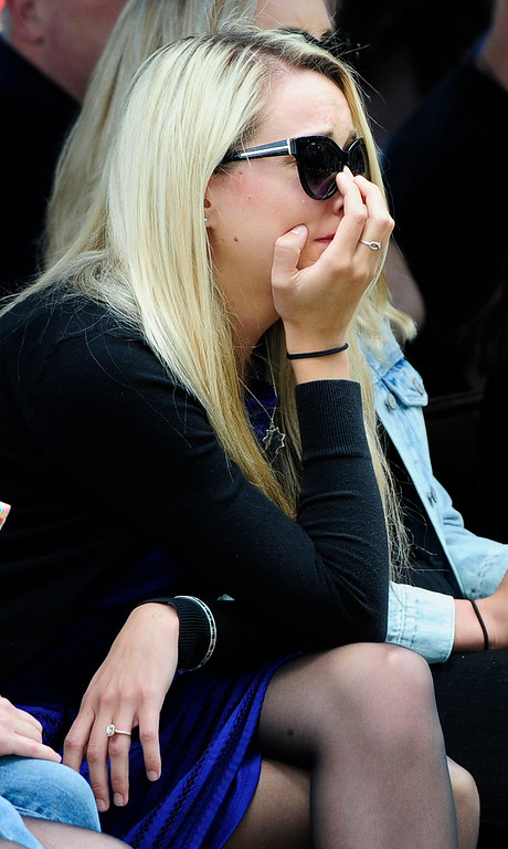 . FAIRFIELD, CA - MAY 16, Justine Capoot gets emotional has her dad\'s name, Vallejo Police Officer Jim Capoot, is read during the 2018 Peace Officers\' Memorial Service on Wednesday in Fairfield. (Chris Riley/Times-Herald)