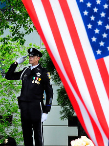 FAIRFIELD, CA - MAY 16, Sgt. Brent Garrick with the Vallejo Police Department salutes during the National Anthem at the 2018 Peace Officers' Memorial Service on Wednesday in Fairfield. (Chris Riley/Times-Herald)