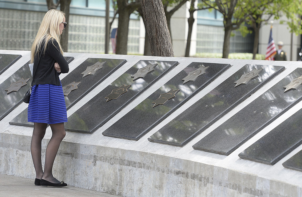 . Before the start of the 2018 Peace Officer\'s Memorial, Justine Capoot  of Vacaville spends some time alone as she stands next to the star that bears the name of her father, James that is part of the memorial wall of Solano County law enforcement officers who were killed or died in the line of duty. Joel Rosenbaum -- The Reporter