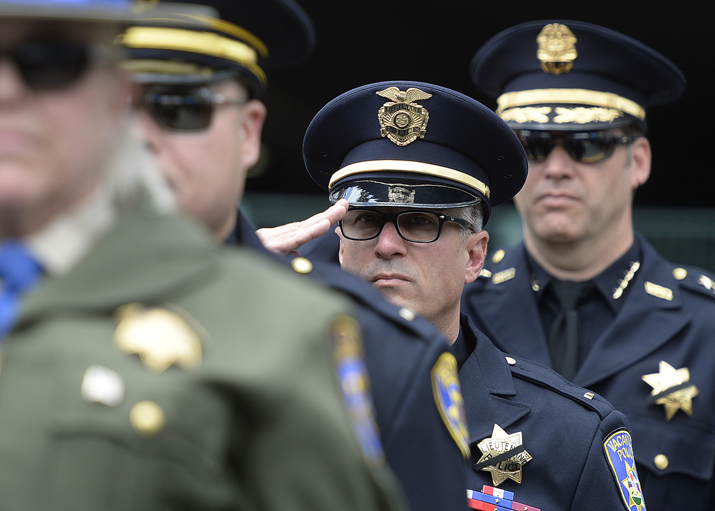 . Vacavile Police Department Lt. Mark Donaldson salutes as the national anthem is sung at the beginning of the 2018 Peace Officer\'s Memorial Wednesday in Farifield. Joel Rosenbaum -- The Reporter